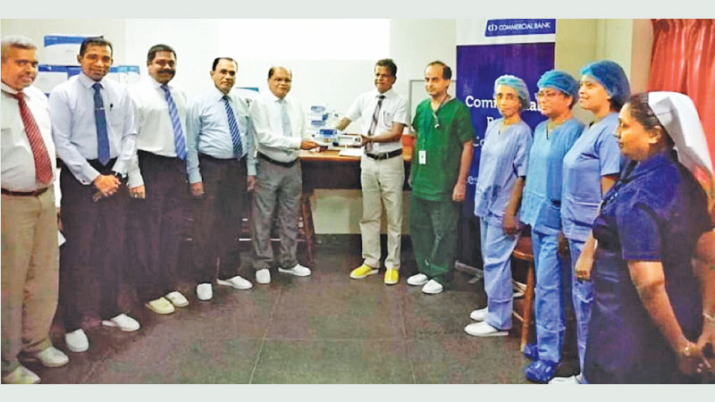 Representatives of Commercial Bank and the Lady Ridgeway Hospital at the donation