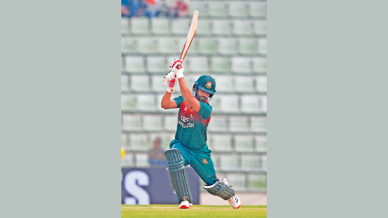 Bangladesh's Tamim Iqbal plays a shot during the second one day international (ODI) cricket match against Bangladesh in Sylhet International Cricket Stadium on Tuesday. – AFP