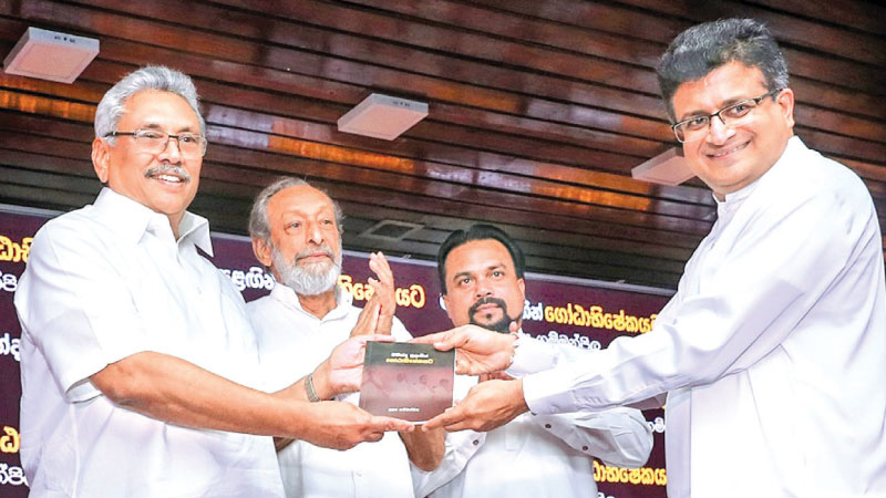 Former MP Udaya Gammanpila presenting the book to President Gotabaya Rajapaksa at the SLFI  yesterday. Picture by President's Media.
