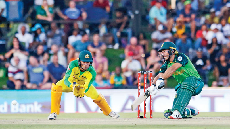 South Africa's Janneman Malan (R) watches the ball after playing a shot as Australia's Alex Carey (L) looks on during the second one-day international (ODI) cricket match at the Mangaung Oval in Bloemfontein on Wednesday. – AFP
