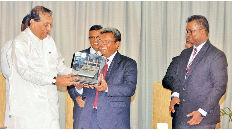SERVICE AT PARLIAMENT HONOURED The Speaker, Deputy Speaker and Deputy Chairmen of committees of the Eighth Parliament were felicitated at Parliament premises yesterday. Here, Parliament Secretary General Dhammika Dasanayake presenting a memento to former Speaker Karu Jayasuriya. (Picture by Vipula Amarasinghe)