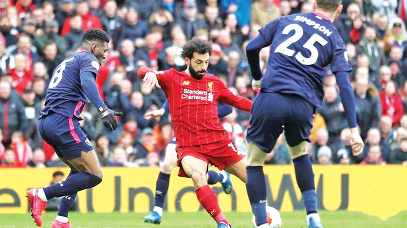 Liverpool's Mohamed Salah scores their first goal against Bournemouth.