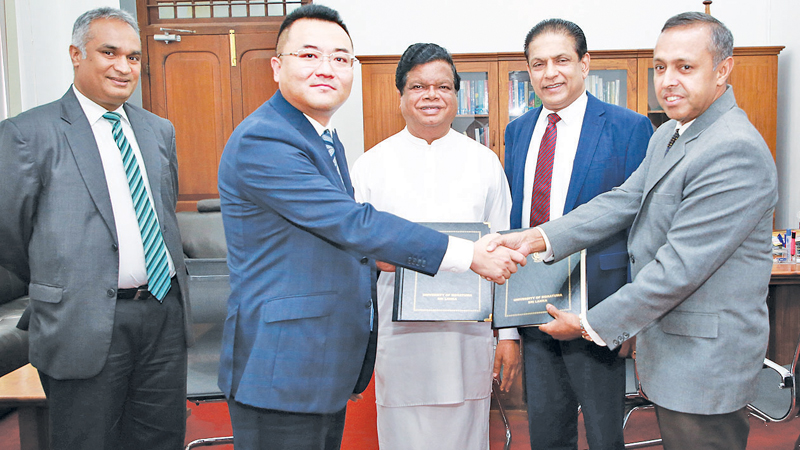 Officials exchange the MoU