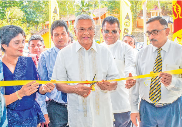 Minister of Mahaweli, Agriculture, Irrigation and Rural Development, Minister of Internal Trade, Food Security, Consumer Welfare and State Minister of Defence,  Chamal Rajapaksa with officials from the bank opens the NSB branch