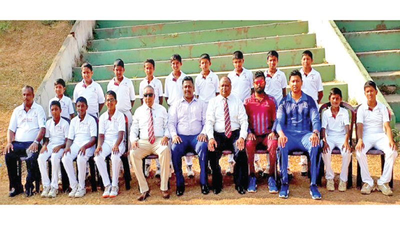Champion CCC School of Cricket Maroons team with officials