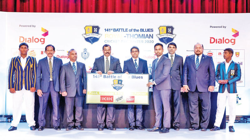 Chief Executive Officer at Keells Food Products PLC/Vice President at John Keells Holdings PLC Sumudu Thanthirigoda handing over the sponsorship to B. A. Abeyrathna, Principal of Royal College and Asanka Perera - Sub Warden at S. Thomas' College.