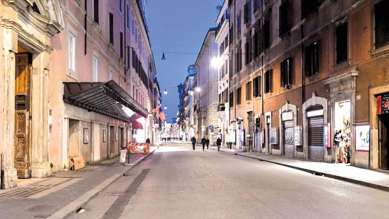 A deserted Via del Corso shopping street near Piazza del Popolo in Rome after Italy imposed unprecedented national restrictions on its 60 million people to control the deadly COVID-19 coronavirus. - AFP