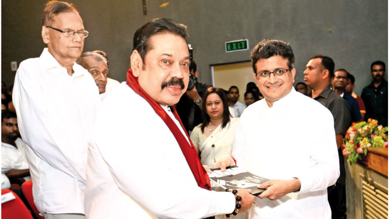 Prime Minister Mahinda Rajapaksa receiving the book from former MP Udaya  Gammanpila. Picture by Sulochana Gamage