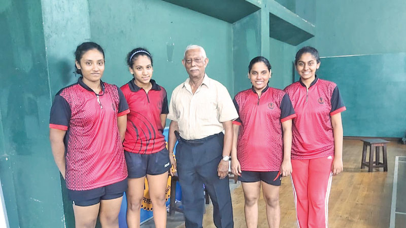 Ladies College team (from left): Githara, Ayla (captain), N H Perera (coach), Zeenath and Minali.