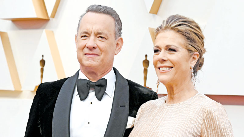 File photo showing US actor Tom Hanks and wife Rita Wilson at the 92nd Oscars at the Dolby Theatre in Hollywood, California on February 9, 2020. - AFP