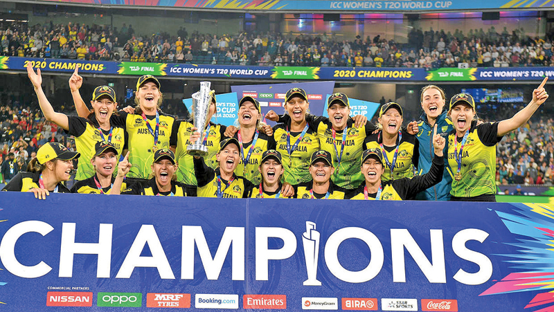 Australia celebrate after being crowned Women's Twenty20 World Cup champions.