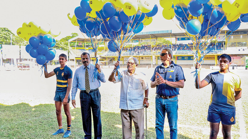 The guest of honour Summa Navaratnam (center) releases balloons at the grand opening of the first match. Principal of Royal College B.A. Abeyratna (second from left) is also present.