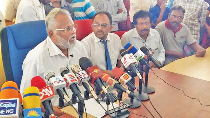 Minister Douglas Devananda at the media conference at the Oluvil Harbour. Picture by A.B. Abdul Gafoor, Ampara District Group Corr.