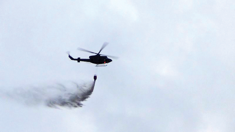 Air Force personnel dousing the fire.