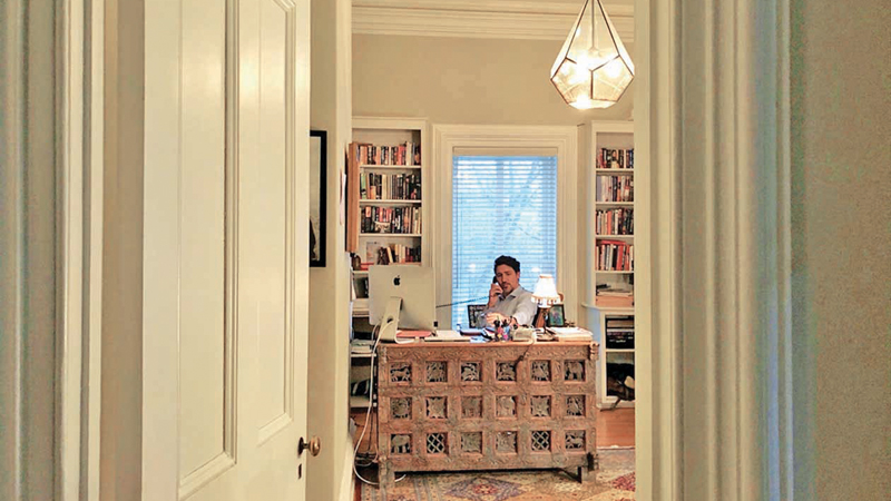 This handout photo released from the Twitter account of Canadian Prime Minister Justin Trudeau and taken on Friday shows him in self-isolation working from home in Ottawa, Canada after his wife, Sophie GrÈgoire Trudeau, tested positive for coronavirus (COVI-19).
