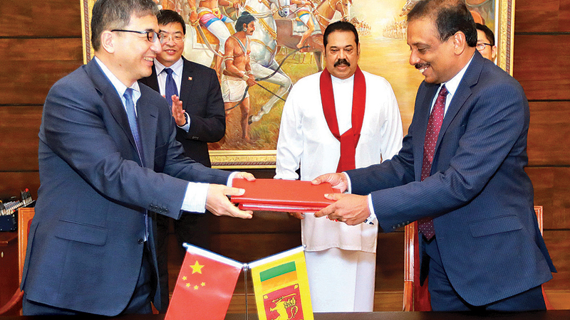 The Government of Sri Lanka and the China Development Bank entered into an agreement yesterday for a financing facility of USD 500 million at Temple Trees. The agreement was signed by S.R.Attygalle, Secretary to the Treasury and Wang Wei, Deputy Director General, China Development Bank. Prime Minister Mahinda Rajapaksa, Chargé d'affaires of the Chinese Embassy Hu Wei and Vice President of CDB Ma Xin were present.
