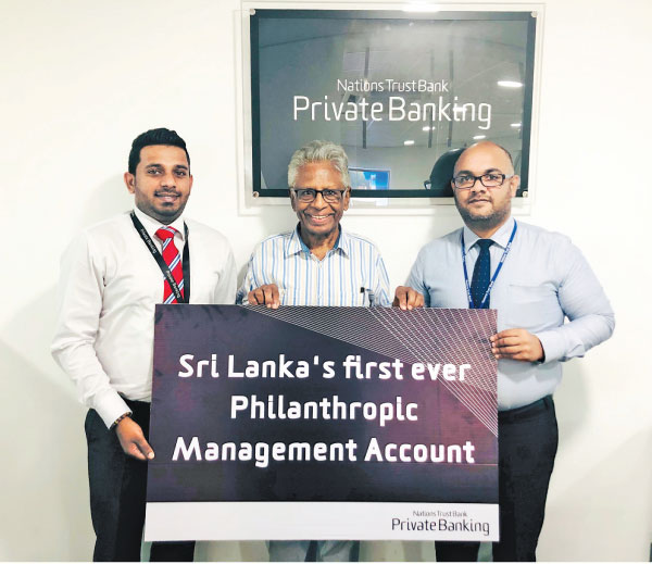 Nations Trust Bank Private Banking representatives with Private Banking customer at the launch of the Philanthropic Management Account at the Maharagama Branch.