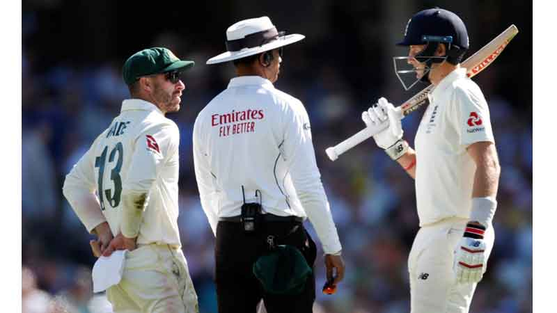 Umpire Kumar Dharmsena intervenes as Australian Mathew Wade and England captain Joe Root get involved in a sledging incident at the Oval.