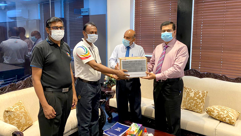 Niranjan Selvadurai, General Manager and S. Balamurugan Deputy Marketing Manager Diagnostics of Sunshine Healthcare's Medical Devices team handing over the PCR test kits to Kanchana Jayarathna, Private Secretary to the Minister of Health and Dr. Sunil De Alwis, Additional Secretary at the Ministry of Health.
