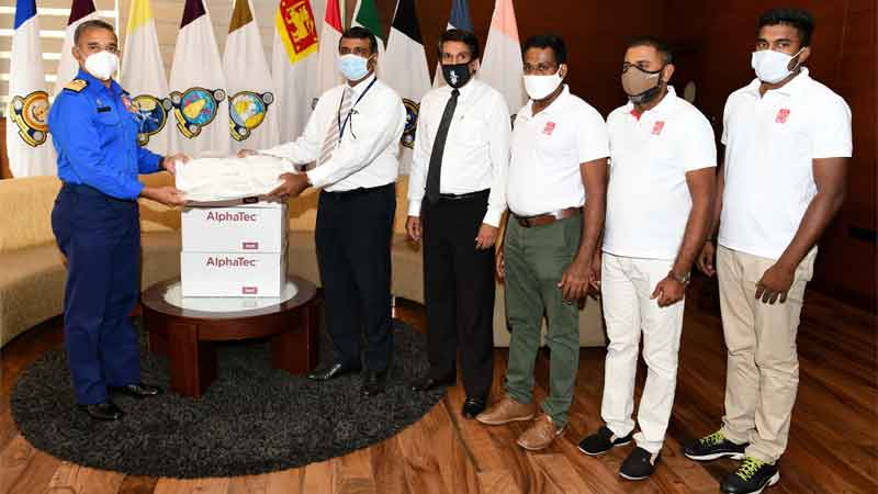The 1,000 protective body suits being handed over to Vice Admiral Piyal De Silva by LOLC and Manusath Derana