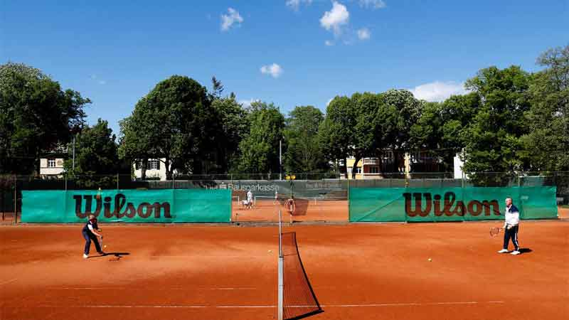 An elderly couple plays tennis in the Smashing Suns tennis club as the government loosened a seven-week lockdown due to the coronavirus disease (COVID-19) outbreak in Vienna, Austria on Saturday.