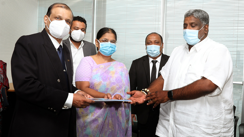 AASL Chairman Major. Gen. G.A. Chandrasiri presenting his proposals to Tourism and Aviation Ministry Secretary Marina Mohamed while Minister Prasanna Ranatunga looks on.