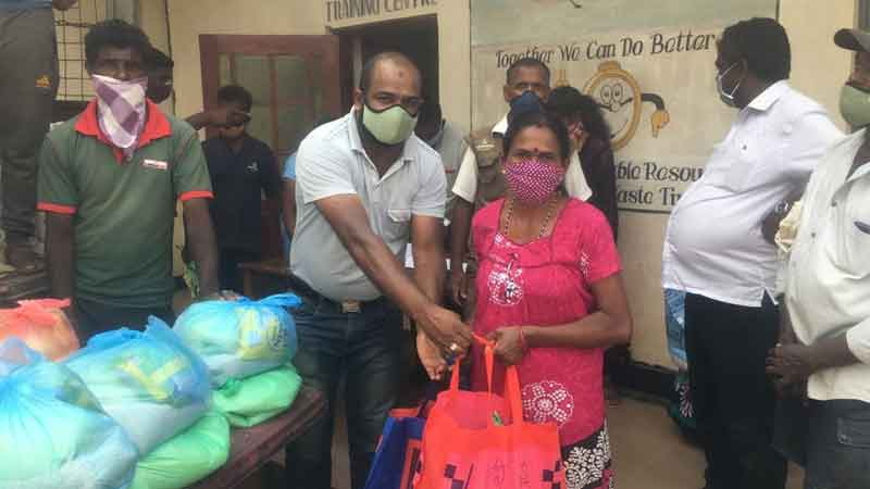 Essential food, dry rations being provided to estate community members