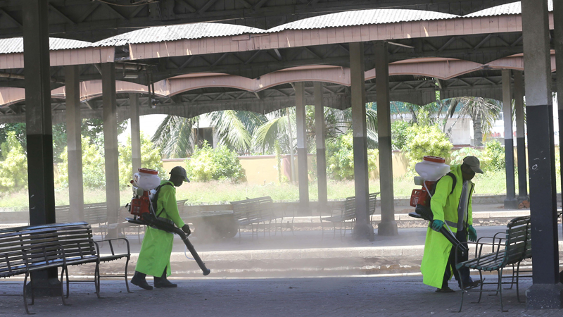 Workers disinfect Fort Railway Station in Colombo, Sri Lanka