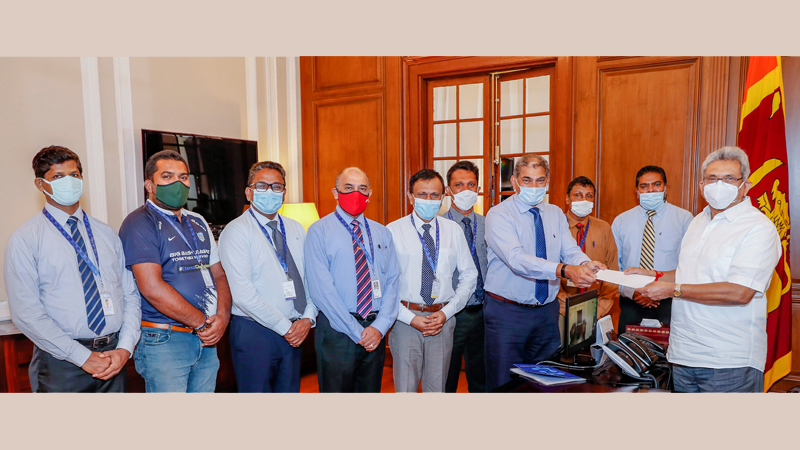SLT Group Chairman Rohan Fernando handing over the cheque to the President