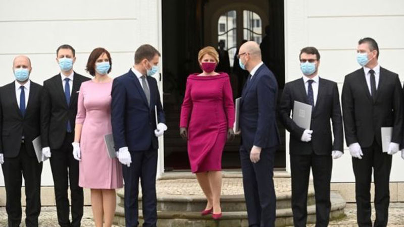 Slovakia's President Zuzana Caputova (centre) has worn masks that match her outfits when out in public