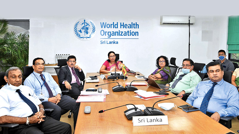 Health Minister Pavithra Wanniarachchi addressing the 73rd Sessions of the World Health Assembly (WHA).  Health Services Director General Dr. Anil Jasinghe and Health Ministry officials look on.