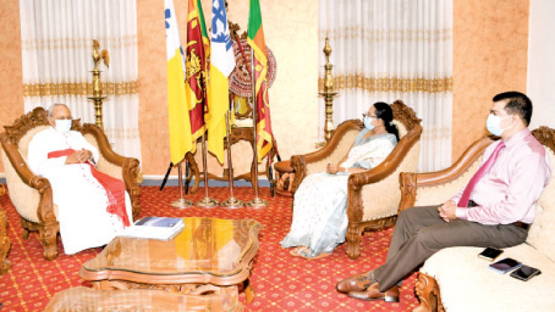 Health Minister Pavithra Wanniarachchi and Archbishop of Colombo His Eminence Cardinal Malcolm Ranjith during the meeting.
