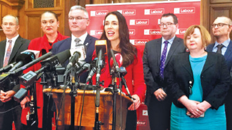 New Zealand's Prime Minister Jacinda Ardern (C) speaks to the press in Wellington, New Zealand, on Tuesday.