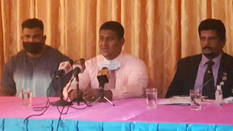 Former president of Sri Lanka Bodybuilding and Fitness Federation and current secretary of Ja-ela Urban Council Kapila Kumara speaking at the press conference. Lucian Pushparaj and Aravinda Wijeyamanna are also present.