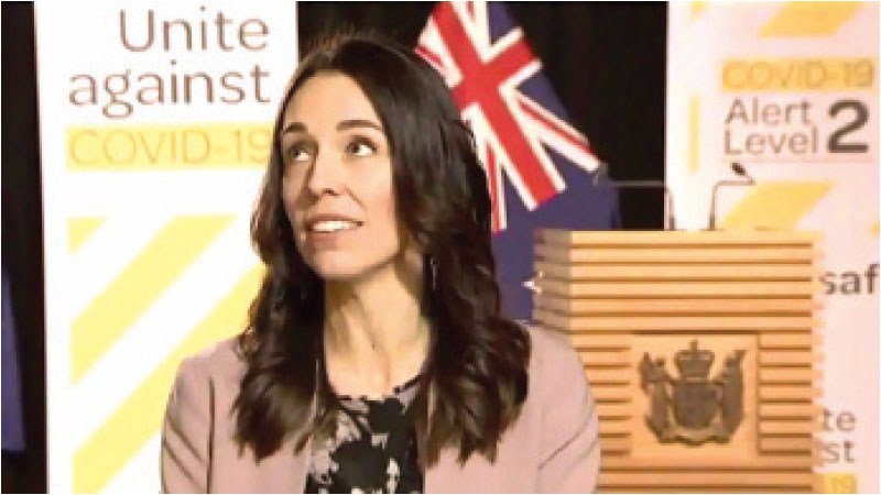 New Zealand Prime Minister Jacinda Ardern looks up when an earthquake struck during a live television interview in Wellington, New Zealand on Monday.