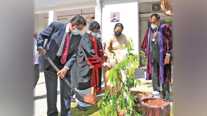 Health Minister Pavithra Wanniarachchi and Higher Education and Media  Minister Bandula Gunawardena planting a sapling to mark the occasion.