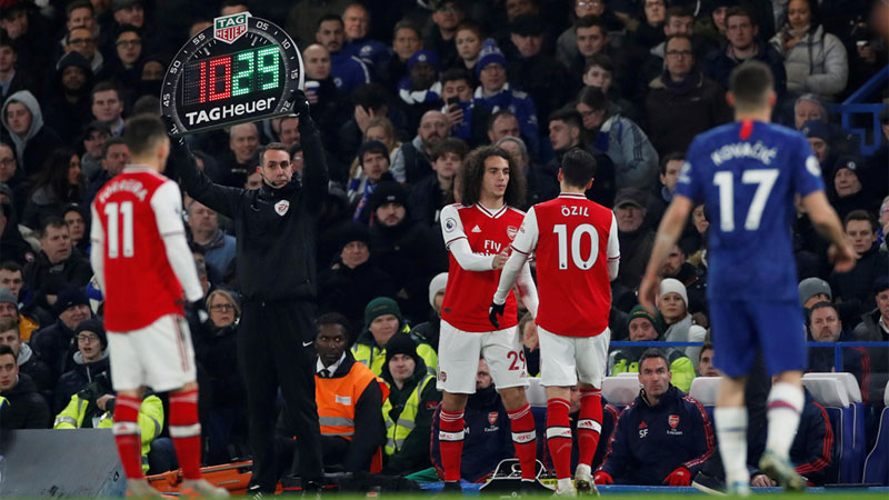 Arsenal's Matteo Guendouzi comes on as a substitute to replace Mesut Ozil in the Premier League match against Chelsea at Stamford Bridge, London.