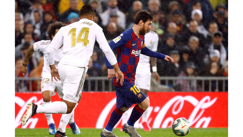 Barcelona's Lionel Messi in action with Real Madrid's Casemiro.