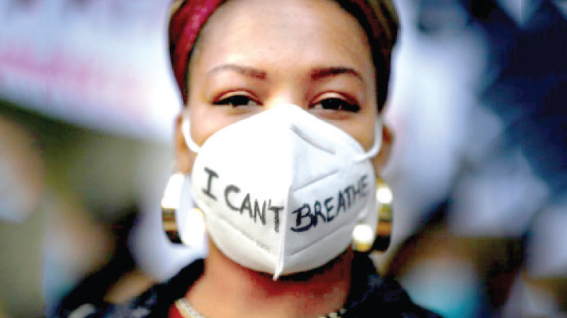"""Thousands of people gathered in a number of European cities to protest against racism. Here, a woman wearing a """"I can't breathe"""" mask during a demonstration in Madrid, Spain following the death of George Floyd in Minneapolis, Minnesota, US on May 25."""