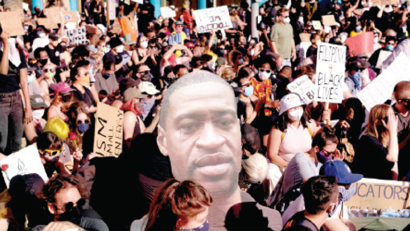 Protesters march holding placards and a giant portrait of George Floyd during a demonstration against racism and police brutality, in Hollywood, California on June 7, 2020. - Demonstrations are being held across the US following the death of George Floyd on May 25, 2020, while being arrested in Minneapolis, Minnesota. - AFP