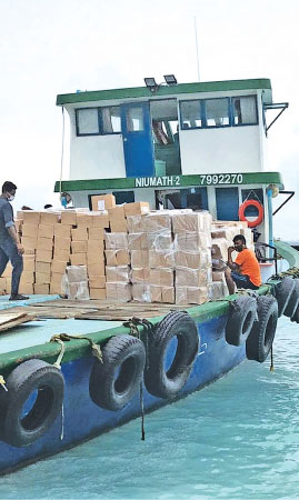 A stock of dry rations is carried to Maldives from Sri Lanka.
