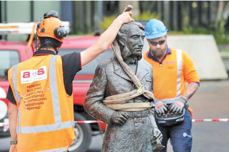 The sculpture of Captain John Fane Charles Hamilton being removed from the city square after requests from the Maoris and threats from anti-racism protesters to topple it. - AFP