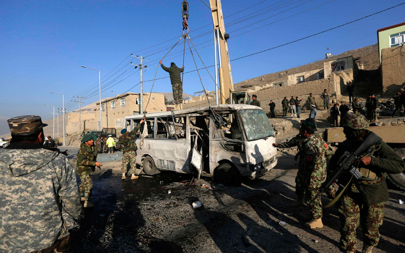 Afghan National Army personnel (ANA) inspect the site of a suicide attack in Kabul.