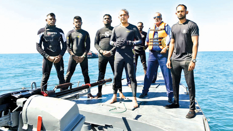 Navy Commander Vice Admiral Piyal De Silva and a team of Navy officers at the site of the underwater museum. Pictures courtesy Sri Lanka Navy