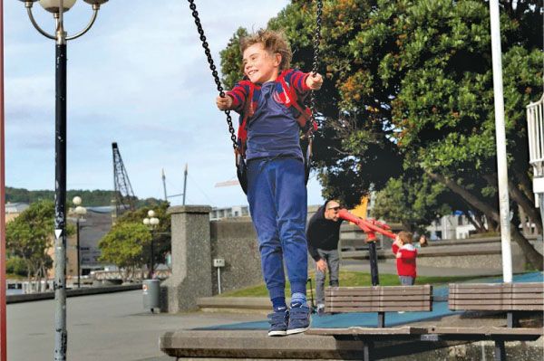 A child plays on a swing at a park in Wellington, New Zealand.