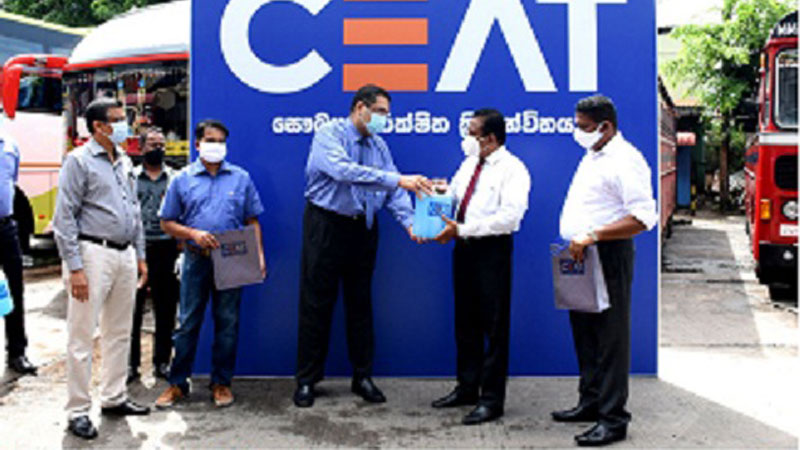 CEAT Kelani Managing Director Ravi Dadlani makes a symbolic presentation to SLTB Chairman Kingsley Ranawaka in the presence of CEAT Kelani Deputy General Manager Sales RegionB Indika Ellepola and Chief Financial Officer Arindam Chakrabarti and SLTB Deputy General Manager Operations Panduka Swarnahansa. SLTB Chairman Kingsley Ranawaka tests a hand sanitizer unit installed on a bus.
