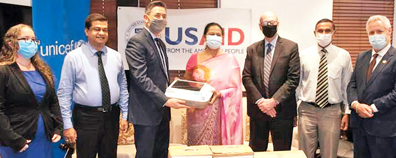 Martin Kelly, Deputy Chief of Mission, US Embassy in Colombo handing over critical equipment to Pavithra Wanniarachchi, Minister of Health, Nutrition and Indigenous Medicine while Alena Tansey, Deputy Director, Office of Governance and Vulnerable Populations, USAID Sri Lanka and the Maldives, Kanchana Jayaratne, Coordinating Secretary to the Minister of Health Nutrition and Indigenous Medicine, Reed Aeschliman, Mission Director USAID Sri Lanka and the Maldives, Chandragupta, Additional Secretary (Developmen