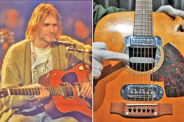 The late Nirvana front man Kurt Corbain with his his acoustic-electric 1959 Martin D-18E guitar.