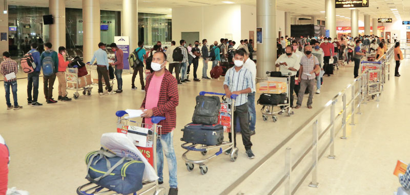 Indians in queue at the BIA to go home.