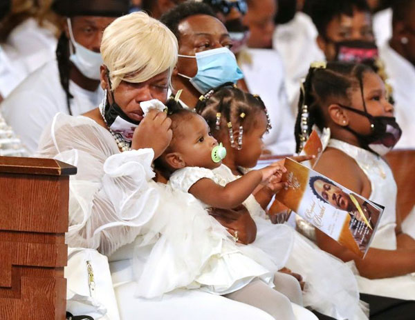 Tomika Miller, the wife of Rayshard Brooks, weeps while holding their one-year-old daughter Dream during his funeral in Ebenezer Baptist Church on Tuesday in Atlanta, Georgia.